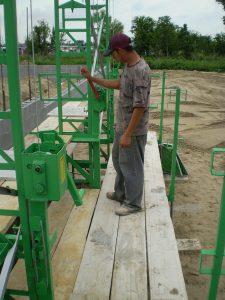 Laborer cranking Standard-Duty scaffolding