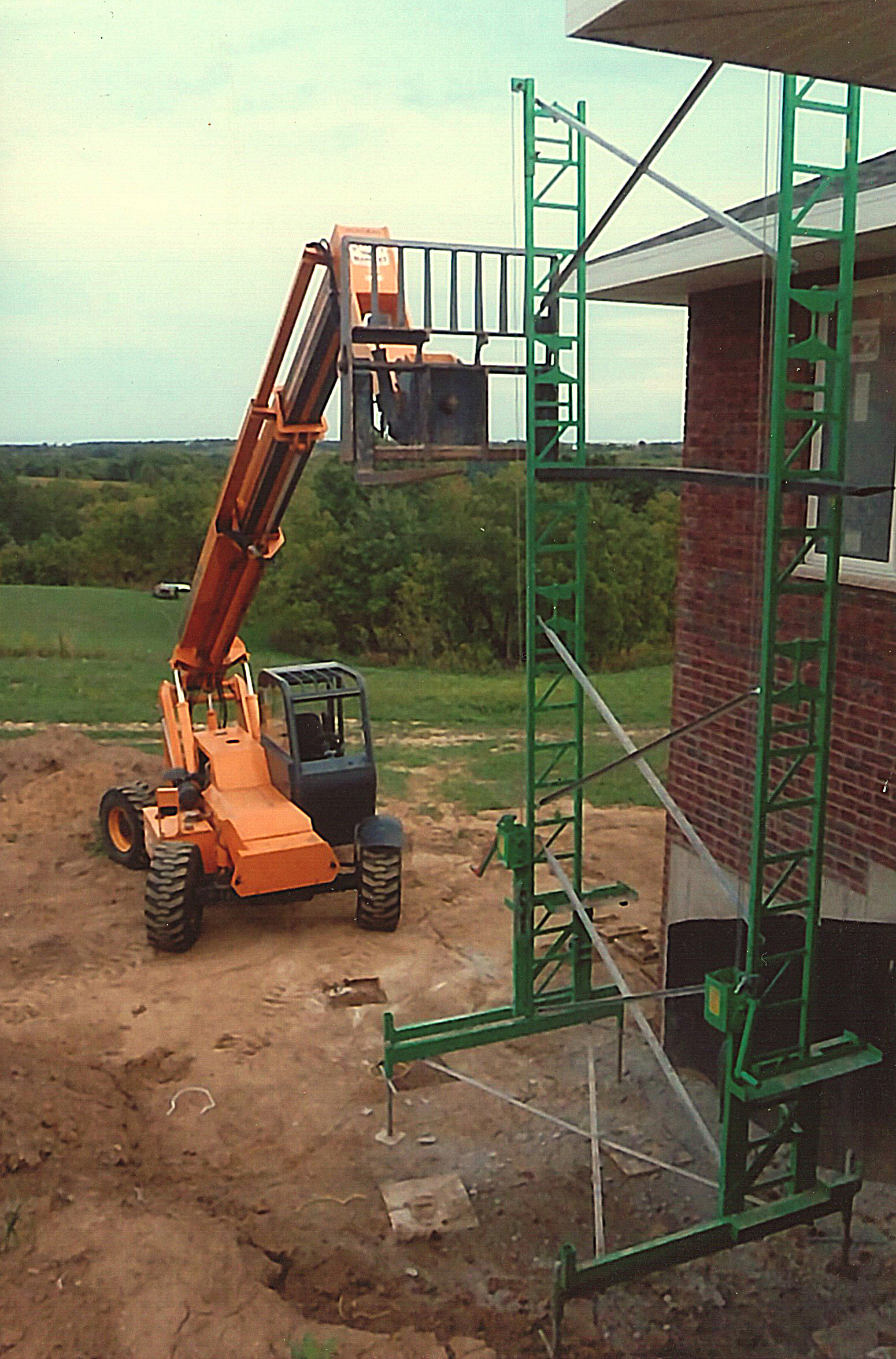 Long fork lifting from side of scaffold